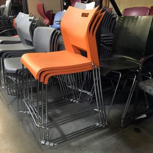 orange cafe stools with chrome base