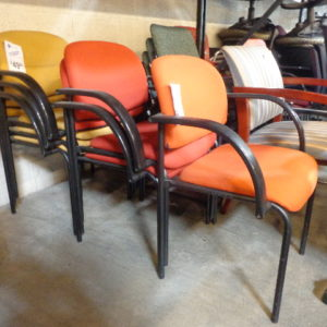 used stack chairs various colors